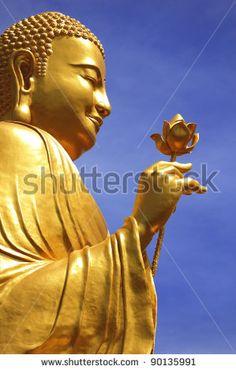 Big Golden Buddha with Lotus Flower  at Da Lat, Vietnam by Marina Ivanova, via Shutterstock