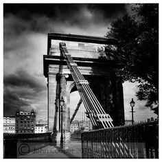 Black and white photograph of the Suspension Bridge over the River Clyde, at South Portland Street, Glasgow.