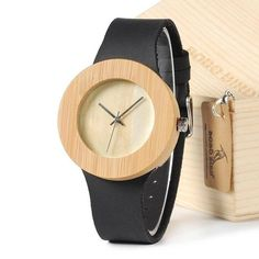Bamboo watch with black handcrafted leather. Modern, minimalist fashion accessories for men and women at our online store. Wrist watch, trendy.