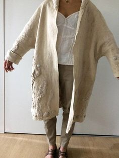 Light beige coat. Completely handmade, without any seams. Thin and warm, delicate and pleasant tactually. Made in the technique of hot felting and used elements of shibori. The coat is made from very soft Australian merino wool. Luxury to the skin,you will not want to take off this beautiful piece! Felted wool garments provide excellent thermoregulation and enable your skin to breathe. Authors design. The coat fits sizes - S / M / L All measurements there are on the last pictu...