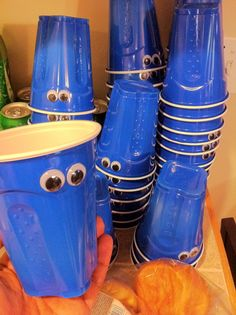 Blue solo cups with googly eyes = COOKIE MONSTER!
