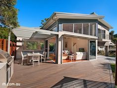 Indoor-outdoor outdoor living design with bbq area & outdoor furniture setting using timber - Outdoor Living Photo 1364404