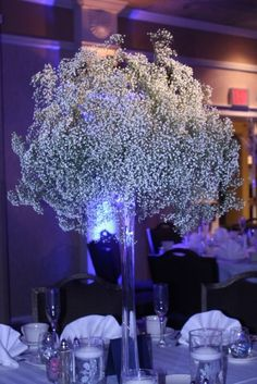 How to #diy tall baby's breath centerpieces..I love how baby's breath looks with the blue uplighting.