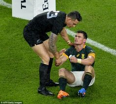All Black Sonny Bill Williams comforts his distraught South African opponent Jesse Kriel a...