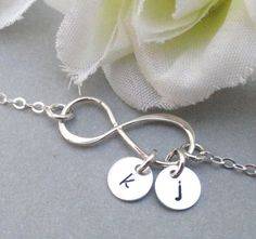 Hey, I found this really awesome Etsy listing at https://www.etsy.com/listing/158173715/personalized-infinity-bracelet-with-two