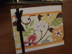 Easy handmade greeting cards.    To make: Fold a piece of textured cardstock in half, then cut to desired size. For the front of the card layer a design paper on top of a solid paper with double sided tape or craft glue (I prefer the tape). Then add ribbon or other embellishments. I like to add a solid color of non-textured card stock on the inside, so the surface is smooth to write on.