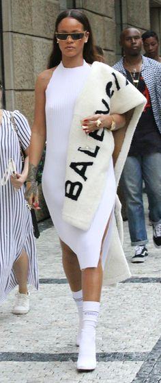 White ribbed dress with a Balenciaga stole.