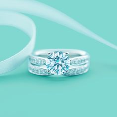 Tiffany Harmony® engagement ring with bead-set border and matching band ring in platinum. #TiffanyPinterest