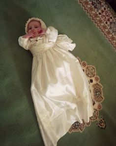 This silk Christening gown was made from twin girl's Communion dresses nearly 30 yrs old. This baby is the 1st to wear the new heirloom gown.