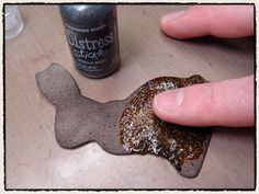 Tim Holtz shows how to use sparkly Stickles to dress up chip board and thick die-cuts. Great for holidays.