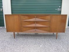 Lovely mid-century modern 3 dimensional walnut diamond front credenza-this piece is in nice vintage condition with minor wear due to age. This piece is presentable as is but would be outstanding with a light refinish to the top.