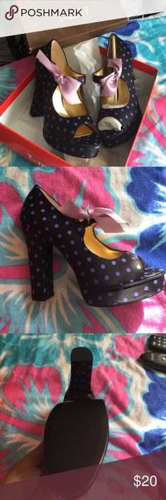 "4"" platform black & purple polka dotted heels. Never been wormed. Brand new in box. They're a size 7.5 but I usually wear an 8 and they fit me perfectly. Super cute and flirty. I never found an outfit to match them and I'm needing to clear out my closet. Will consider reasonable offers. Y-not?  Shoes Heels"