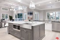 Kitchen ideas pictures the kitchen features a large center island and bright ceiling lights along with smooth white kitchen remodel ideas 2018 pictures Farmhouse Sink Kitchen, Rustic Kitchen, Kitchen Decor, Kitchen Ideas, Kitchen Cabinets, Kitchen Inspiration, Kitchen Carts, Kitchen Grey, Gray Cabinets