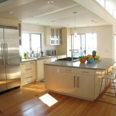 White, Contemporary Beach House Kitchen Filled with Natural Light