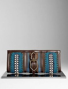 All the tribal trimmings on a single sleek clutch.