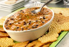 Served hot from the oven, this bean dip is sure to be a hit...made with Cheddar cheese soup, picante sauce and black beans, it's a favorite at casual get-togethers.
