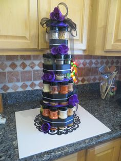 I made this for my future daughter- in- law's Bridal Shower. I could not find kitchen towels i liked to make a towel cake so i decided to use spices. for a spice cake!