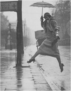 Martin Munkacsi...what a woman will do to not step in the puddles...look at that leap in high heals!!