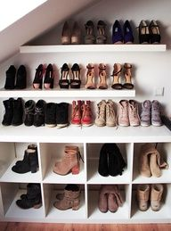 make use of that unused space under the stairs for storing shoes and boots