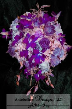 purple cascade bouquet with wedding flowers such as orchids, astilbe, and tulips, Dallas wedding flowers by AntebellumDesign.com