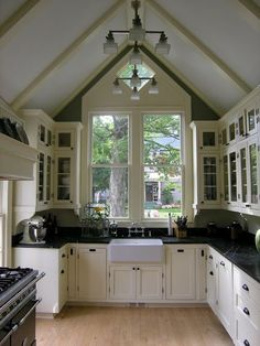 black soapstone countertops with white cabinets and glass fronts and big windows. yep, it's perfect.