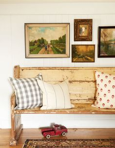 Christi's secret to getting a high-end look for less? Paying up for small quantities of expensive fabrics, like the block-printed pillows in the dining room and on the hallway bench (a former church pew). To offset that cost, she chose more affordable patterns, such as the buffalo check curtains in the dining room, for projects that required more yardage.   - CountryLiving.com