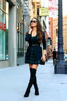 short green plaid tartan dress, blue cardigan and over the knee boots.