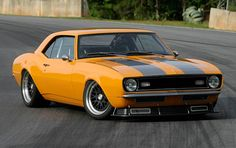 """1968 """"Velocity"""" Camaro. Not usually a fan of orange, slamming, or black wheels w/ chrome lip but here they all work great. Should ditch the front spoiler though."""