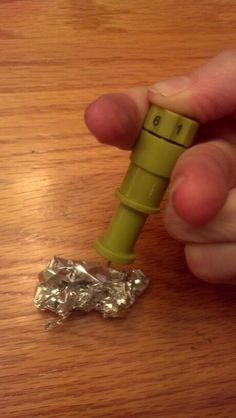 Peirce a ball of aluminum foil to sharpen your cricut blade by Nadine Godwin