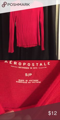 Cute long sleeve t shirt. Rarely worn. Aeropostale red tee. Super cute tied up to the side! Shows up pinky orangish on camera but is red like pictured on tag photo. Aeropostale Tops Tees - Long Sleeve