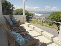 """Whale Rock #Hermanus The unit is delightfully """"Beach House"""" furnished and has 3 bedrooms. The main en-suite offers a king size bed with luxurious open en suite bathroom."""