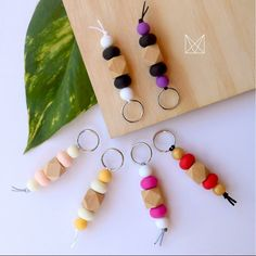 mini teethers instead of metal ring use tiny wood rings I have and organic cotton chord.