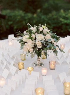 Escort card table: http://www.stylemepretty.com/illinois-weddings/lake-forest/2015/05/20/elegant-tented-backyard-lake-forest-wedding/ | Photography: Annie Parish - http://www.annieparishphotography.com/