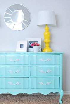love this little vignette: painted tiffany blue dresser with a small scalloped mirror and a sunny yellow lamp