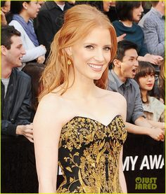 Jessica Chastain in yellow and white diamonds by Harry Winston Rumor has it that they are worth 2 million dollars!