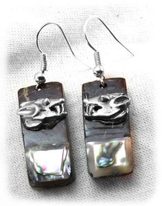 Fine earrings of pewter Aztec design incrustation on coconut with abulone shell.