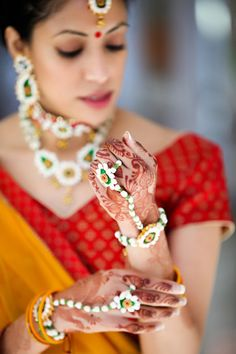 Image by Keith Cephus Indian Bridal Fashion, Indian Bridal Wear, Asian Bridal, Bridal Fashion Week, Flower Jewellery For Mehndi, Jewellery Diy, Flower Jewelry, Jewellery Designs, Indian Jewelry Earrings