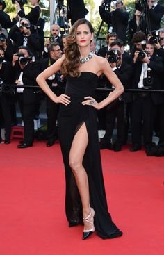 "Emilio Pucci Liked · Yesterday   Izabel Goulart wears an Emilio Pucci black chiffon strapless gown to the Premiere of ""The Immigrant"" during the 66th Annual Cannes Film Festival at the Grand Theatre Lumiere"