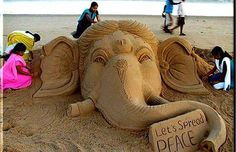 Incredible elephant sand sculpture