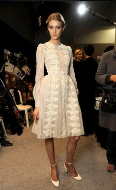 long sleeved white lace dress with full skirt and high neck