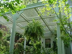 Pergola- I like the look of the supports. Instead of lattice on top, something for rain.