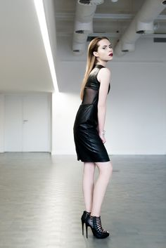 Leather dress D066.  An elegant leather dress which gives every stylization strength and femininity underlined by a tulle element which uncovers the fragment of the back.