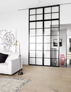 There's nothing as sleek as a glass partition. They're often used in office spaces, but totally appropriate for the home, too! Check out these glass partitions perfect for dividing a room in your home. For more interior ideas, go to Domino. Interior Barn Doors, Interior Exterior, Interior Architecture, Modern Interior, Interior Windows, Classical Architecture, Interior Styling, Steel Windows, Windows And Doors