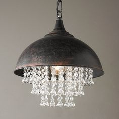 "This rustic bronze metal dome has urban appeal with added flair from chic strands of waterfall acrylic crystal droplets underneath. One 40 watt medium base socket. Includes 32"" of chain with 5"" round mounting canopy for total max height of 42"". Some assembly required. (15""Hx13.25""W)"