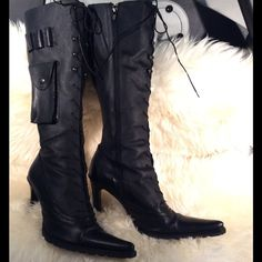 High heeled combat boots lace pointed toe Knee high, lace, pointed toe with side pockets. Man made material, distressed look. Rugged heavy duty and very chic high heeled boots. Gives you that strong tough don't mess with me look but with a very feminine touch. Size is Euro 41. Shoes Combat & Moto Boots