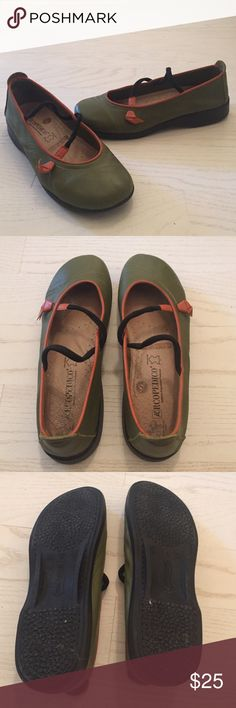 Arcopedico Vitoria Shoes Green Flats These are very comfortable. They are green with an orange trim. There is a scuff on the toe of the right shoe. Tried to capture in the photo above. They are still in good condition. Arcopedico Shoes Flats & Loafers