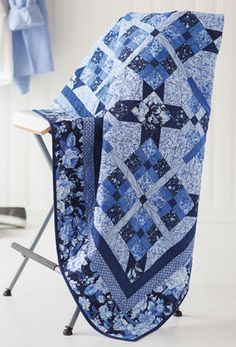 Cool Blue is a throw quilt by Dawn Stewart from the July/August Love of Quilting magazine.