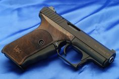 Heckler and Koch P7 Pistol - Sold a bunch working at a gun & fishing store during my collge days. Should have bought one then.