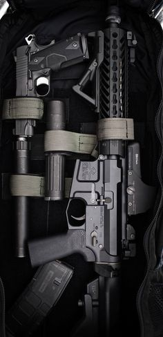 Go to bag. Double D rifle with UCWRG Rifle Grip and suppressed 1911. Photo by Tracerx Photography for Defense Marketing Group