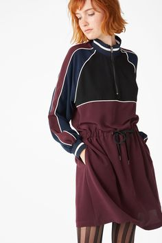 You'll be an all-star in this fun sporty dress. You've got all the retro charm with side-stripe arms, a zippy 3/4 polo neck and a colour-block palette. Hit